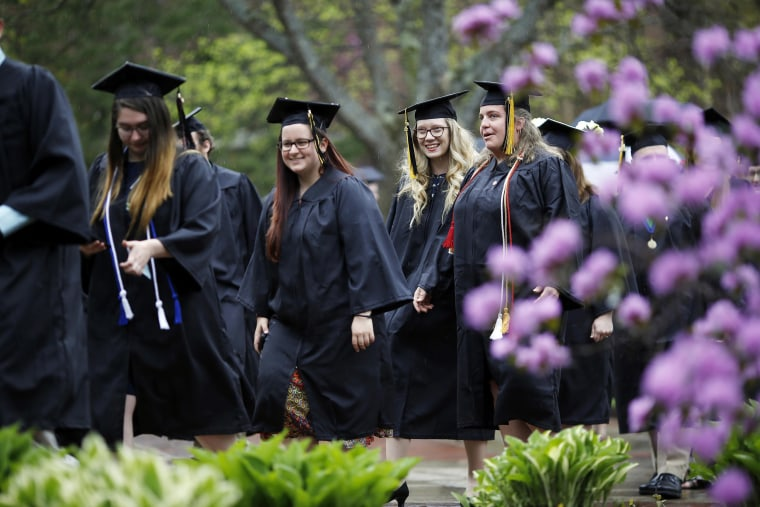 Image: Graduates march in a procession to the 2018 MCLA Commencement at the college in North Adams