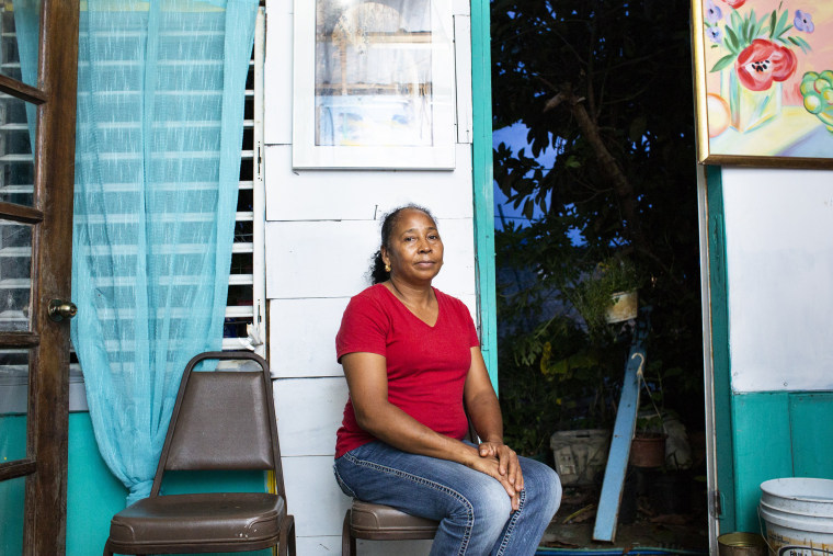 Image: Dulce Morreta-Diaz, 53, in her home at Valle Hill in Canovanas, Puerto Rico