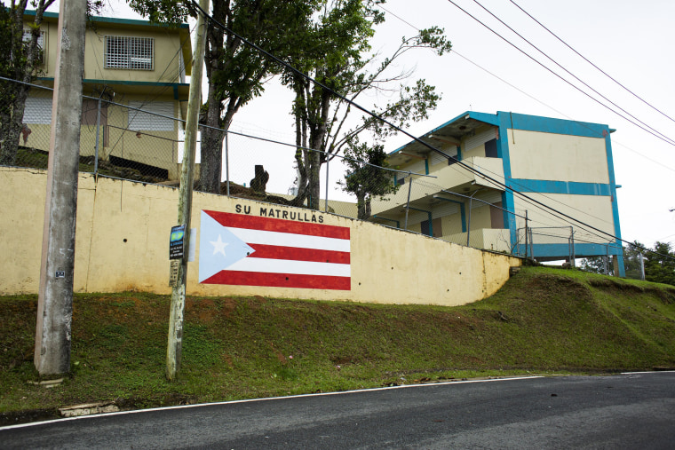 Image: A Puerto Rican flag painted after the storm outside the S.U. Matrullas Elementary School in Orocovis
