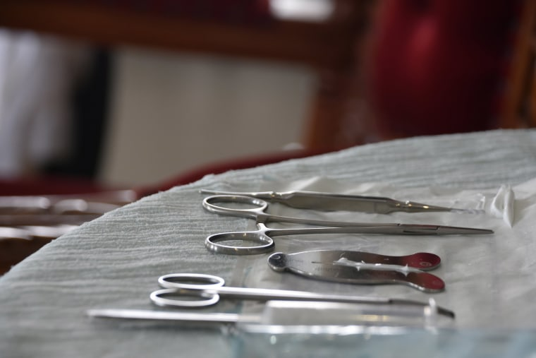 Image: A mohel arranges medical equipment a circumcision ceremony