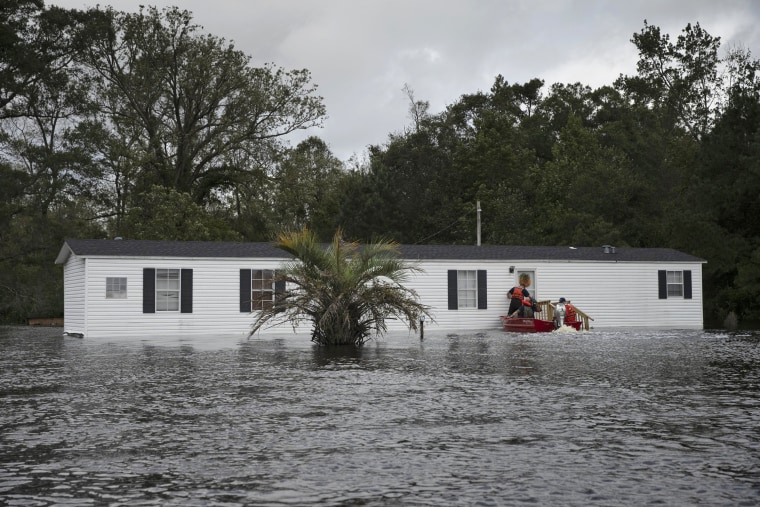 Image: Coast Guardsmen check for residents needing rescuing in a flooded area of Columbus County, North Carolina.