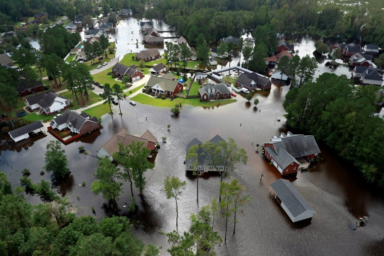 Image: Houses sit in floodwater caused by Hurricane Florence, in this aerial picture, in Lumberton