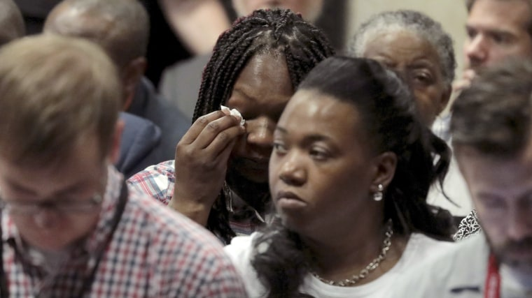 Image: Tina Hunter, center, wipes her eyes as she watches from the gallery during Chicago Police Officer Jason Van Dyke's trial