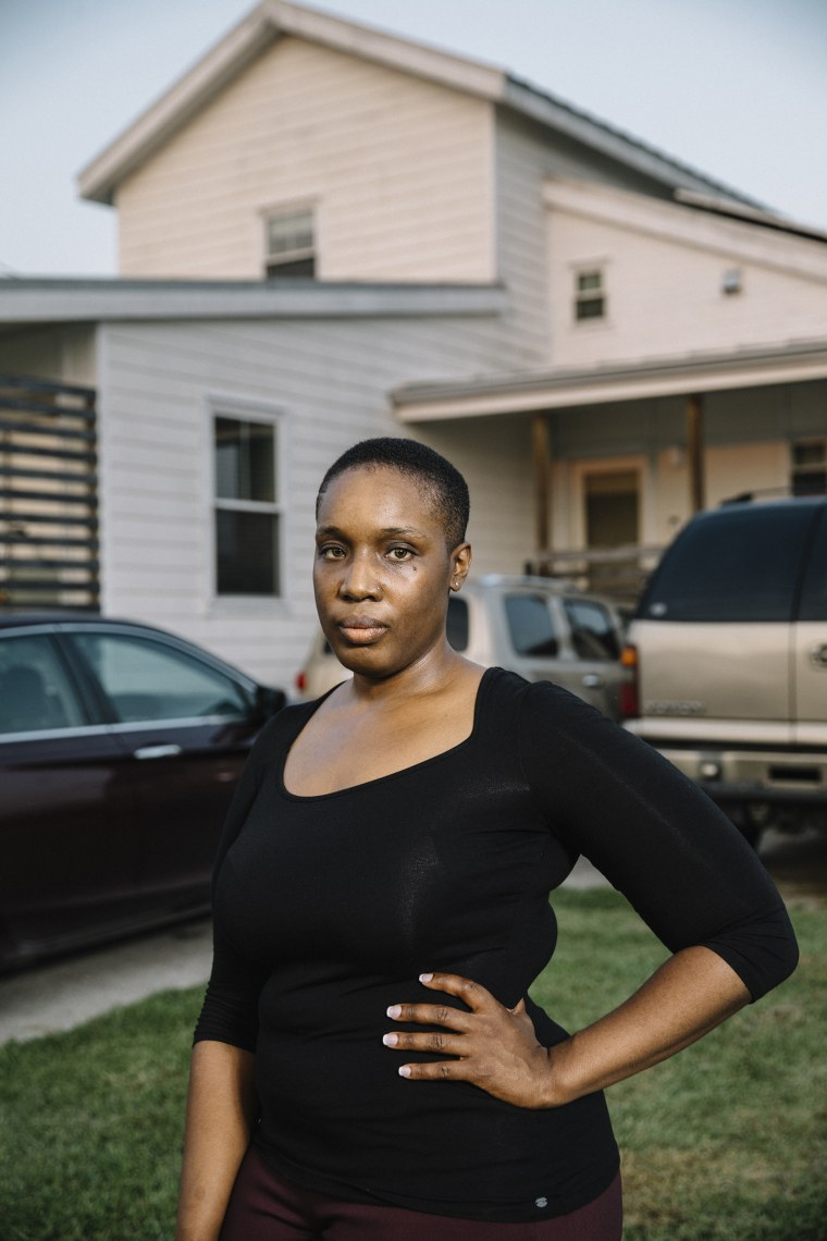 Image: Kamaria Allen stands in front of the home on Jourdan Street