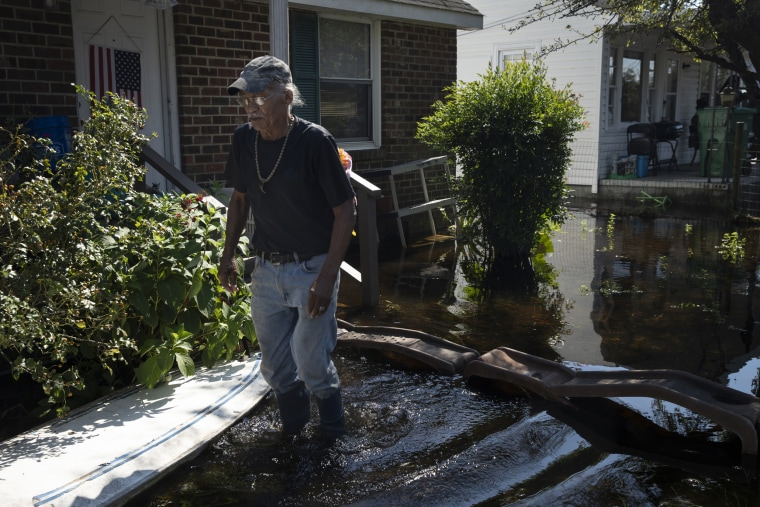 Image: James Emmanuel surveys the flooding in front of his home in Lumberton, North Carolina