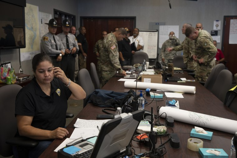 Image: Emergency personnel field phone calls related to the flooding at the Emergency Operations Center in Lumberton, North Carolina
