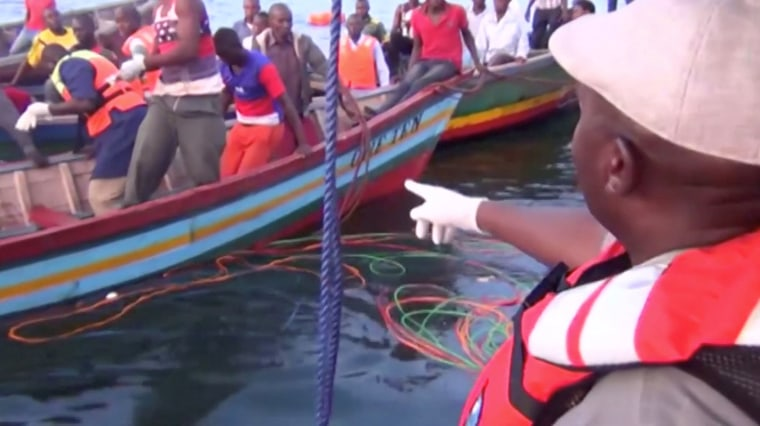 Image: Rescue workers are seen at the scene where a ferry overturned in Lake Victoria