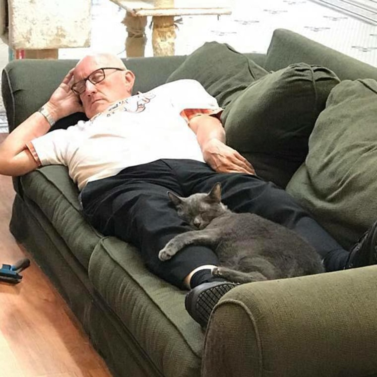 Volunteer Terry naps with cat Louis