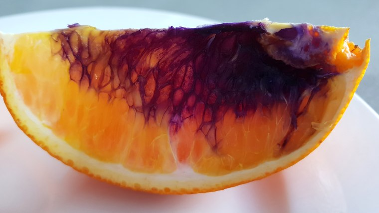 Australian woman sent this orange, which turned purple, to the Queensland Health department for testing.