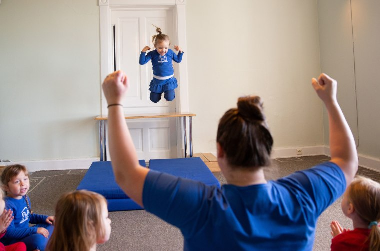 Image: Girls jump off a table during playtime