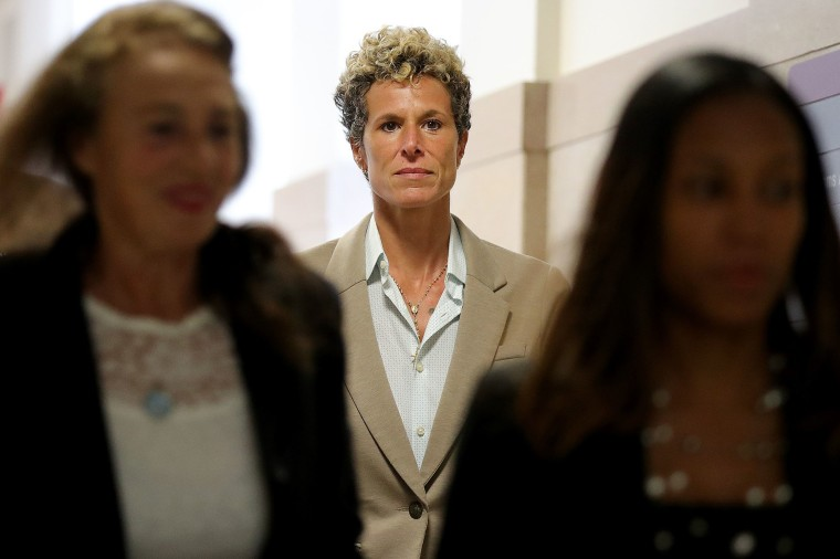 Image: Andrea Constand returns to the courtroom during a lunch break at the sentencing hearing for the sexual assault trial of entertainer Bill Cosby