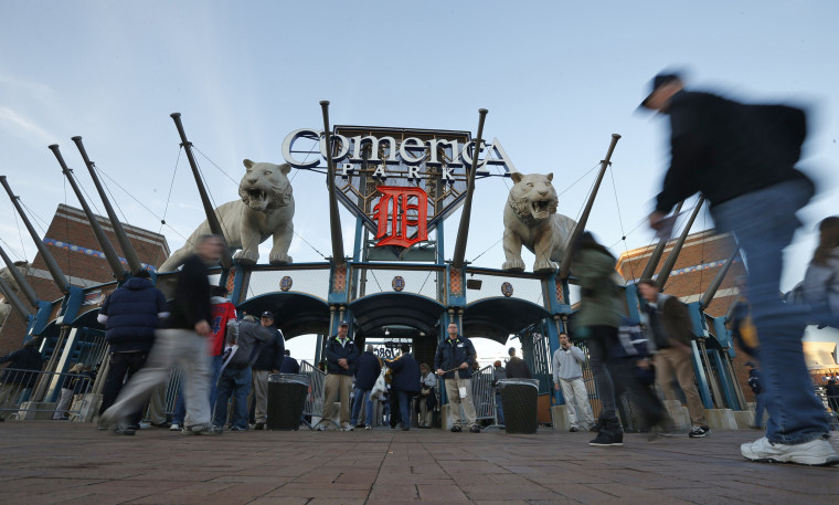 Fans walk in front of Comerica Park before Game 3 of the MLB ALCS baseball playoff series in Detroit