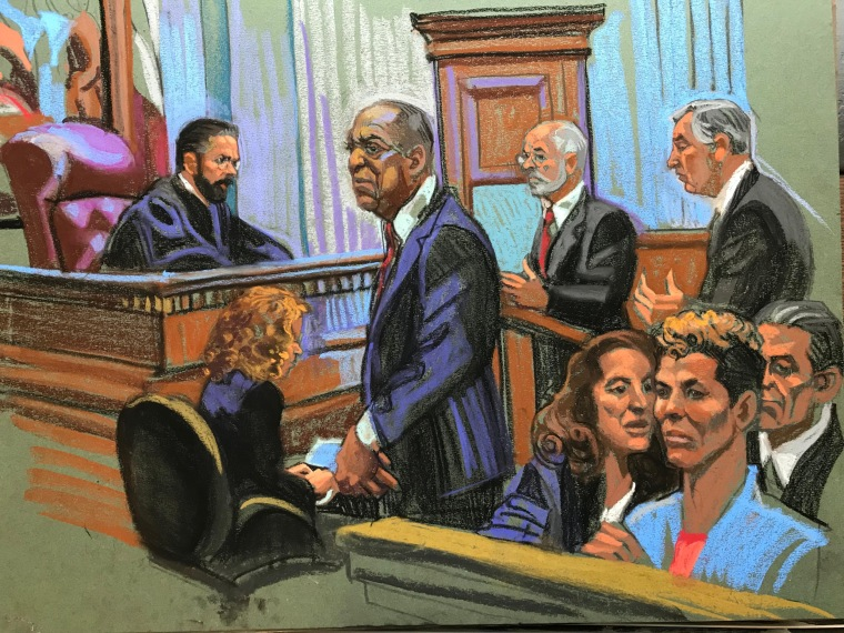 Bill Cosby stands during his sentencing in this courtroom sketch from Sept. 25, 2018.