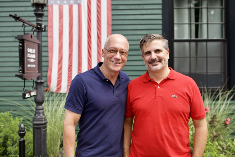 New Hampshire state Sen. Dan Innis, left, with his husband, Doug Palardy, outside the Great Island Inn, which they own, in New Castle, New Hampshire.