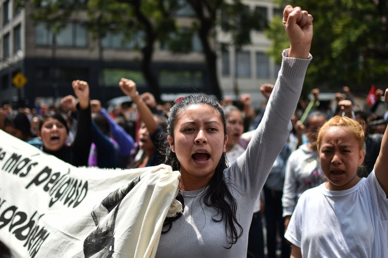 Relatives and comrades of the 43 students of the teaching training school in Ayotzinapa who went missing on September 26, 2014 hold a demonstration