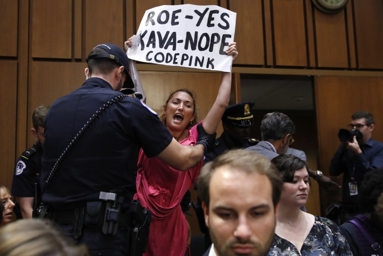 Image: A protester is escorted out of the Kavanaugh confirmation hearing