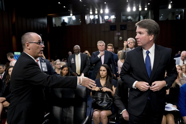 Image: Fred Guttenberg, the father of Jamie Guttenberg who was killed in the Stoneman Douglas High School shooting in Parkland, Florida, left, attempts to shake hands with Brett Kavanaugh