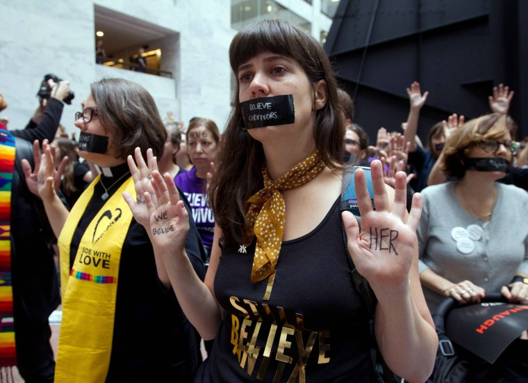 Protestors gather in the Hart Senate Office Building on Sept. 27, 2018 in Washington in support of Christine Blasey Ford, who is testifying against Supreme Court Justice nominee Brett Kavanaugh at a Senate Judiciary Committee hearing.