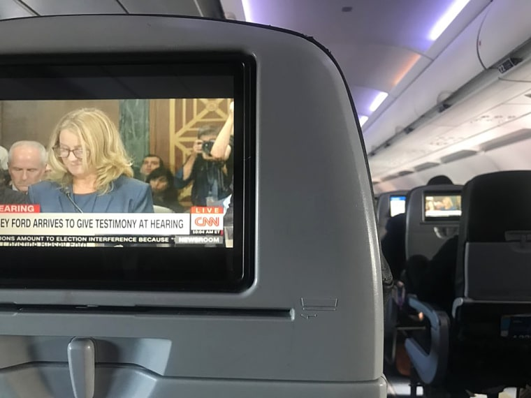 Diara J watching the Kavanaugh hearing on a Jet Blue flight