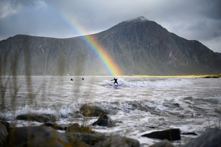 Image: TOPSHOT-SURFING-NORWAY-LOFOTEN-ARCTIC CIRCLE