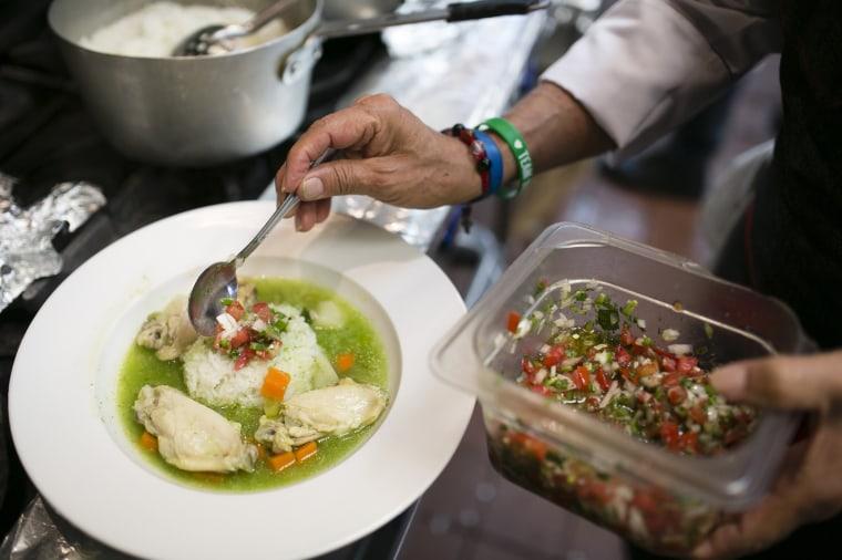 Image: Eddie Hernandez serves cilantro soup