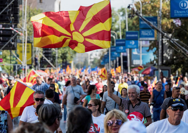 "Image: People wave Macedonian flags as they attend a campaign rally for the ""yes"" ahead of a referendum on wether to change the country's name to ""Republic of Northern Macedonia"""