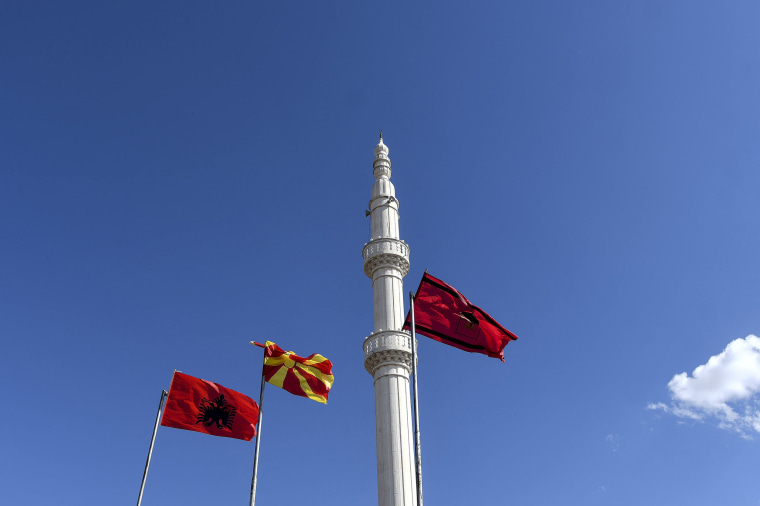 Image: Albanian flags in the village of Arachinovo, where the majority of the population is Albanian