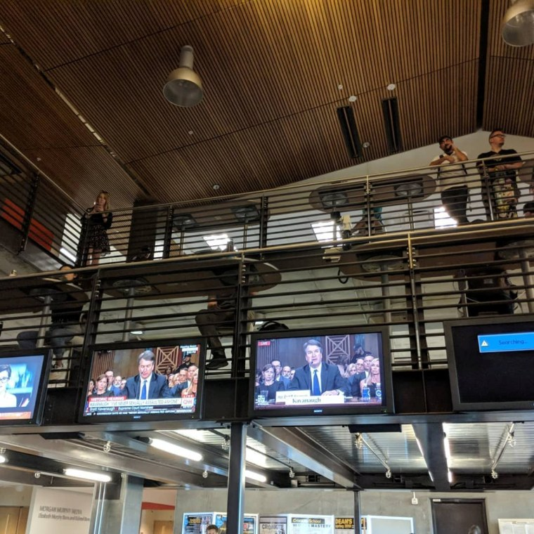 Image: Students watch television screens showing the hearing of U.S. Supreme Court nominee Brett Kavanaugh at the Walter Cronkite School of Journalism and Mass Communication