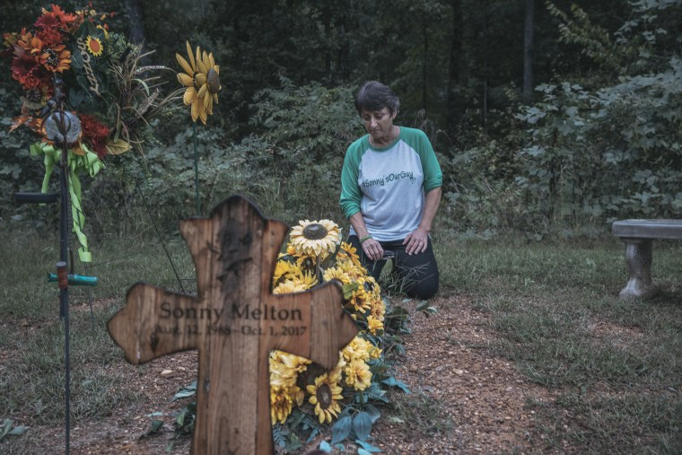 Image: Susan Melton sits by her son Sonny's final resting place at his home in Big Sandy