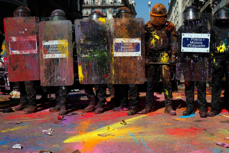 Image: Catalan police 'Mossos D'Esquadra' officers covered in paint.