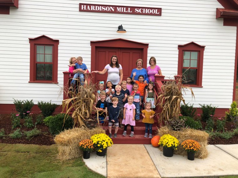 Indy and her friends and teachers on the first day of school.