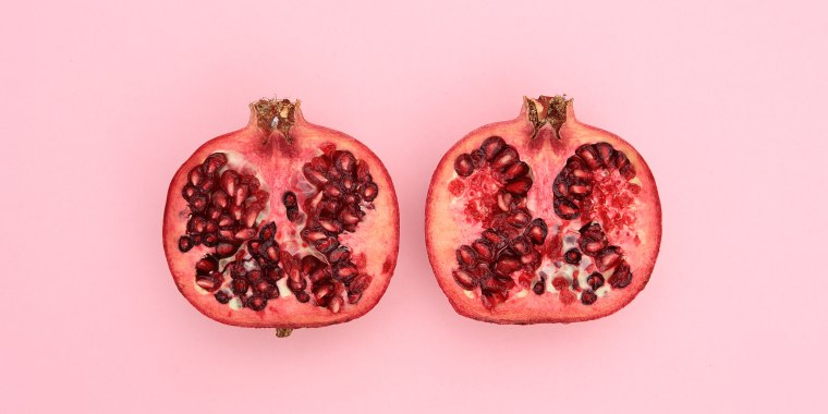 Close-Up Of Pomegranate Slices On Pink Background