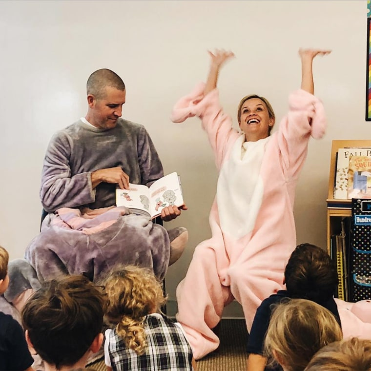 """Reese Witherspoon as a guest reader at a """"Mystery Reader"""" event at her 6-year-old son Tennessee's school and she wore a pig costume to the event."""