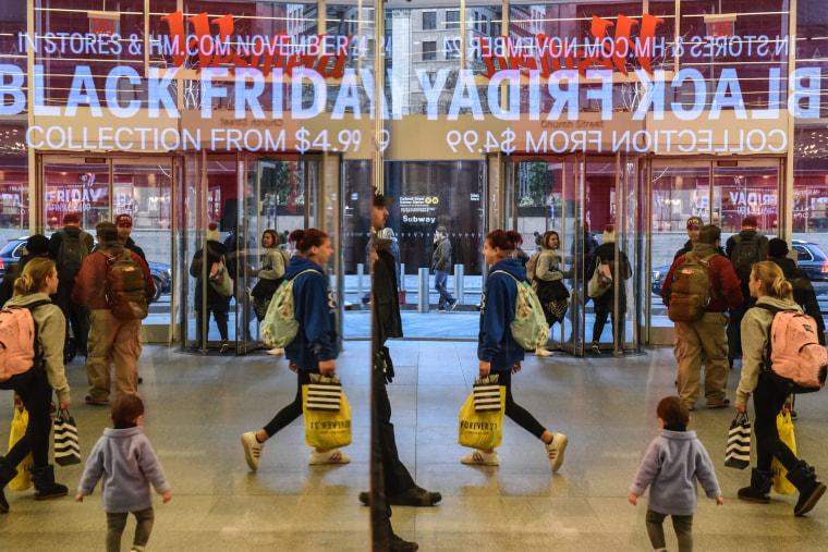 "Image: People shop on \""Black Friday\"""