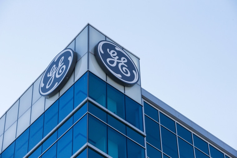 Image: The General Electric logo is displayed at the top of their Global Operations Center in the Banks development of downtown Cincinnati