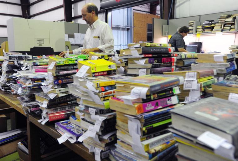 Sorting through books to be discarded at the Lafayette Public Library warehouse in Louisiana in 2013.