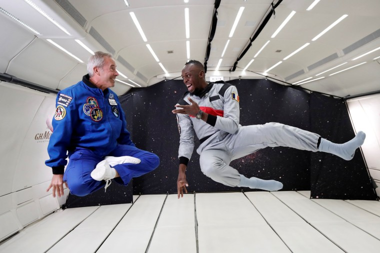 Image: Retired sprinter Usain Bolt and French astronaut Jean-Francois Clervoy enjoy zero gravity conditions during a flight in a specially modified plane above Reims