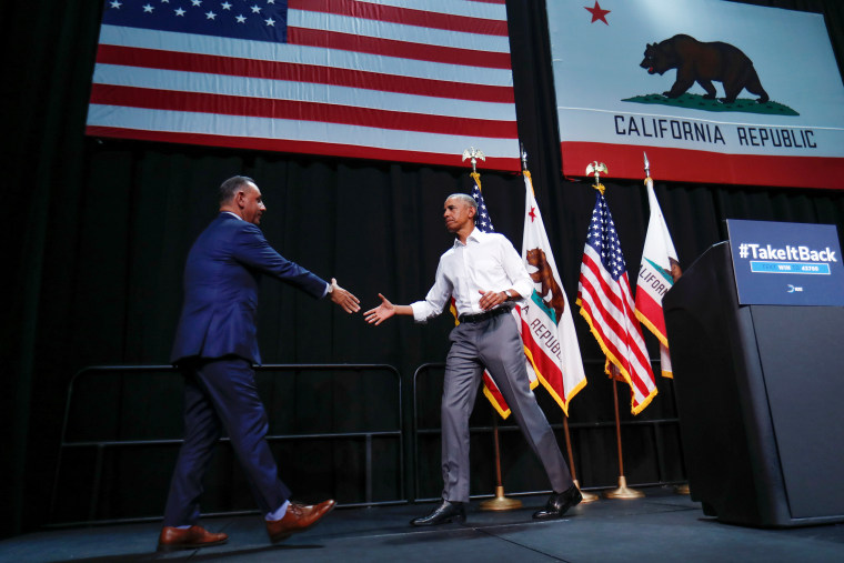 Former President Barack Obama shakes hands with California Democratic candidate Gil Cisneros as he participates in a political rally during a event in Anaheim, California