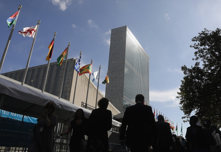 People walk past the United Nations headquarters