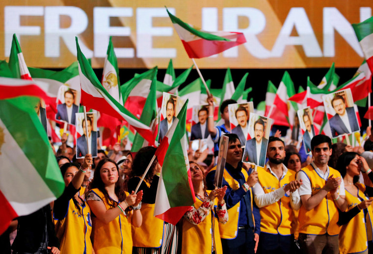 Image: Supporters of Maryam Rajavi, president-elect of the National Council of Resistance of Iran (NCRI), attend a rally in Villepinte, near Paris