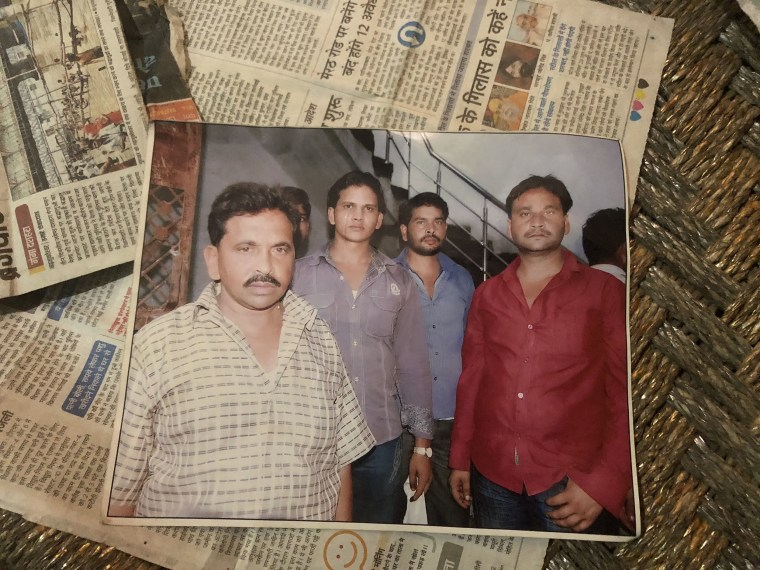 Image: A family photograph of Qasim Qureshi (L) and relatives