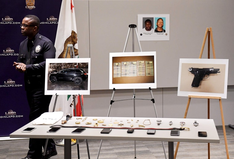 Image: Stolen goods on display at a Los Angeles Police Department press conference to announce the arrest of four suspects in connection to a spate of high profile burglaries