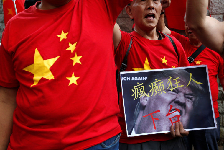 Image: Protesters demonstrate against Donald Trump outside the U.S. Consulate in Hong Kong