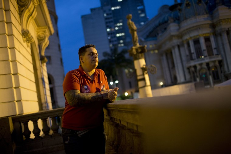 Image: Transgender Cristian Lins stands outside City Hall at the end of an interview in Rio de Janeiro, Brazil