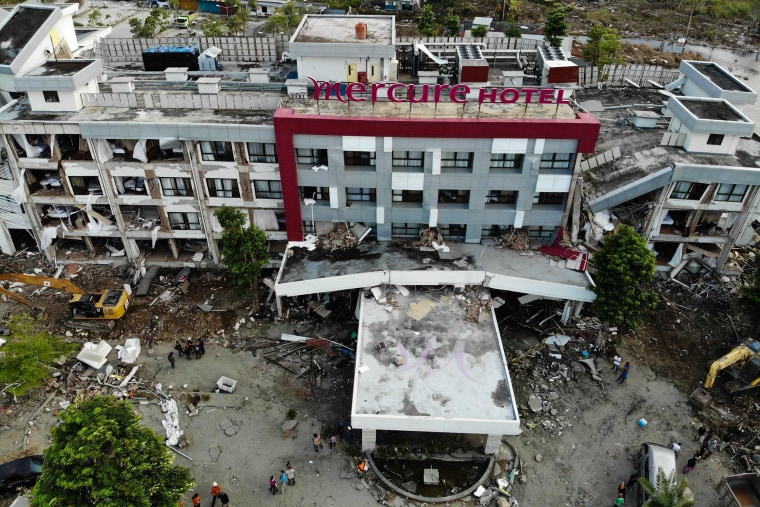 French members of the International Emergency Firefighters and locals search for survivors in the badly damaged Mercure hotel in Palu, Indonesia on Oct. 4, 2018.