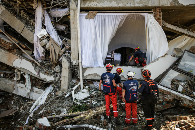 French members of the International Emergency Firefighters prepare to enter the badly damaged Mecure hotel
