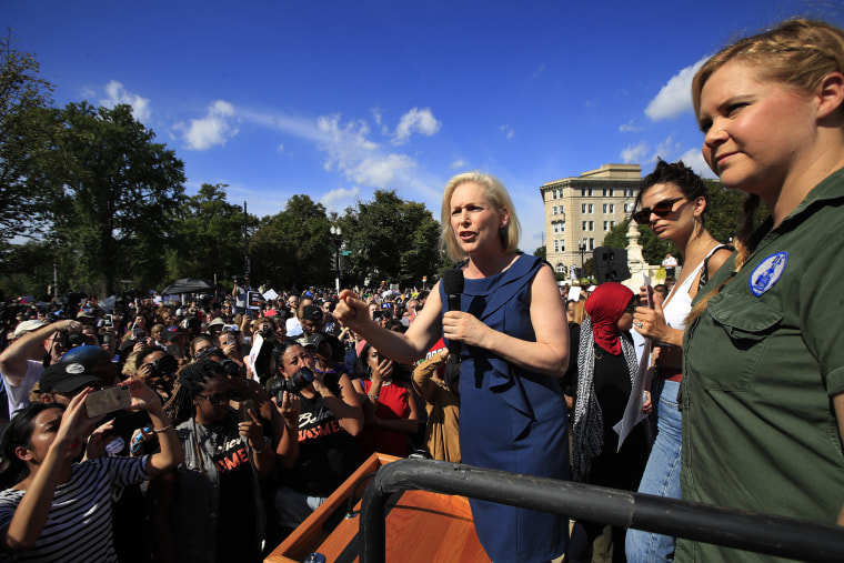 Sen. Kirsten Gillibrand, D-N.Y., with actor and comedian Amy Schumer, right, speaks at a rally against Brett Kavanaugh at the Supreme Court on Thursday.