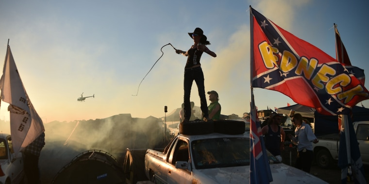 A woman cracks a bull whip on top of her truck at the annual Deni Ute Muster in Deniliquin, Australia, on Sept. 29.