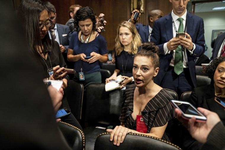 Image: Actress Alyssa Milano is seen before a Senate Judiciary Committee hearing on Sept. 27, 2018