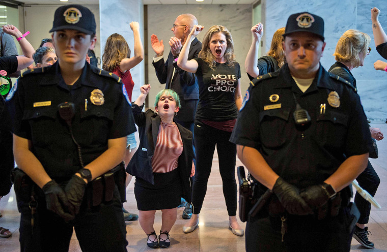 Image: Police look on as protesters are arrested in the Senate Hart building during a rally against Supreme Court nominee Brett Kavanaugh on Capitol Hill in Washington on Oct. 4, 2018.